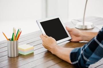 Man holding digital at his desk