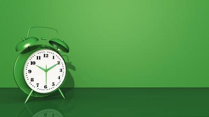 Grüner Wecker vor grünem Hintergrund