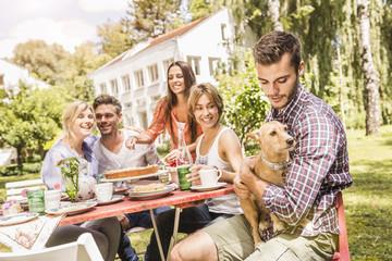Group of friends enjoying garden party