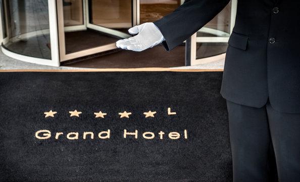 Hotel concierge showing the way