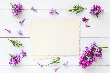 Old empty photo for the inside and frame of fresh lilac flowers