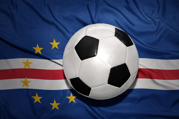 black and white football ball on the national flag of cape verde