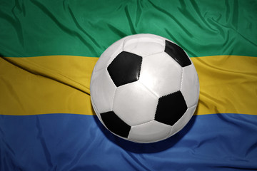 black and white football ball on the national flag of gabon