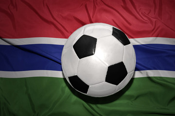 black and white football ball on the national flag of gambia