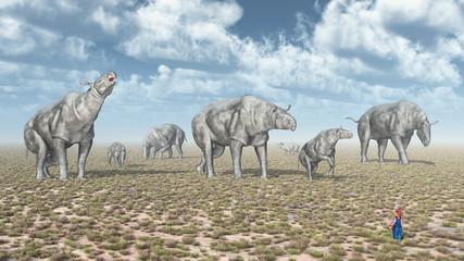 Gruppe von Paraceratheriums und Kleinkind