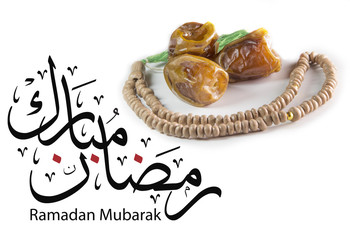 "Ramadan Mubarak greeting card which means ""May you have a blessed Ramadan"" with dates and"