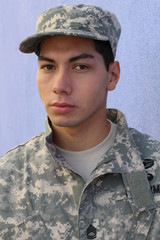 Young latino military man in army uniform
