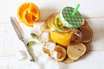 Orange juice and ice cubes