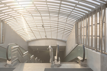 Wide angled view to perspective escalators stairway inside conte