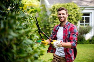 Gardener cutting plants