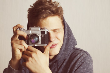 Teenager with analog film camera vintage effect