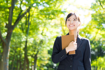 portrait of asian businesswoman in the park
