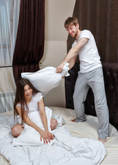 Couple pillow fight.