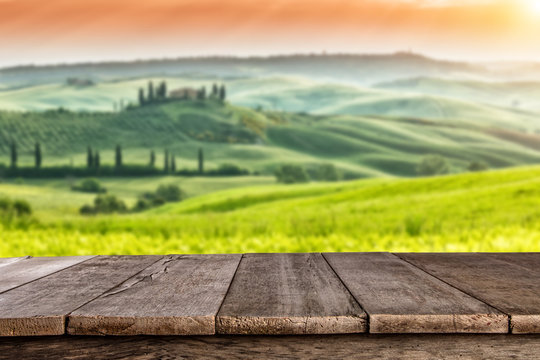 Empty wooden planks with Italian landscape