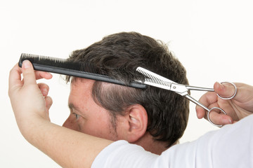 Men's Hairdressers; barbers. Barber cuts the client machine for haircuts.
