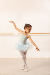Little ballerina girl dancing in ballet studio