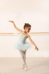 Little ballerina girl dancing in ballet studio
