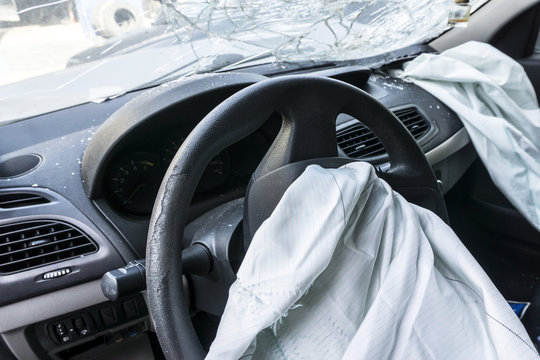 deflated airbags after the erupted inflation due to a car collision
