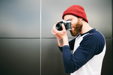 man hipster taking a picture