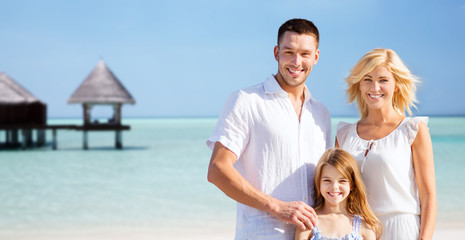 happy family over tropical beach with bungalow