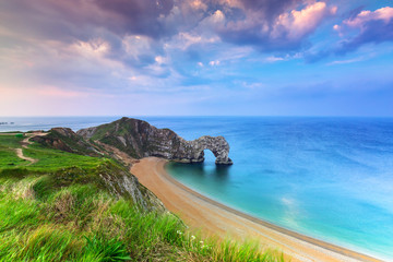 Photo sur Plexiglas Cote Jurassic Coast of Dorset with Durdle Door at sunrise , UK