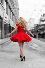 Woman in red dress walking at BW outdoor