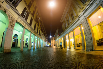 Night city in Italy. Novara. Illuminated street.Toning. Soft focus