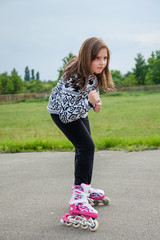 The young girl on rollerblades