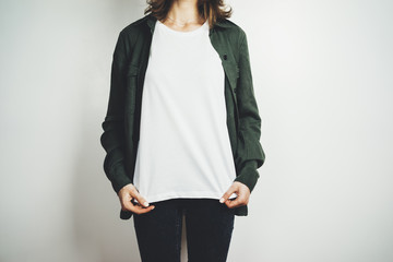Young hipster girl wearing blank white t-shirt, mock-up of template white t-shirt in the white background