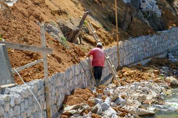 constructing river embankment