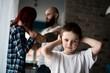 Sad, desperate little boy during parents quarrel
