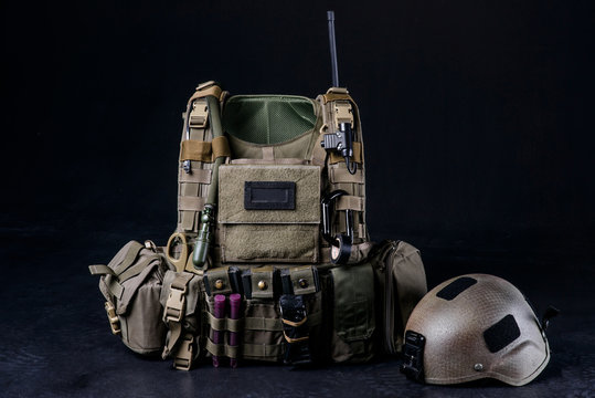 Body armor covers, bulletproof vest/Bulletproof vest,helmet and other military equipment on black background