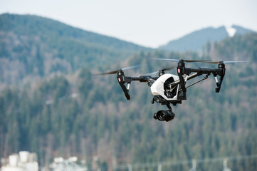 Drone in sky/Drone hovering in sky over mountains
