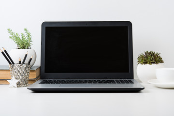 modern work space with laptop mockup on a table