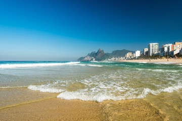 Low Waves on the Sand of Ipanema Beach in Rio de Janeiro