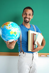 Geography teacher showing globe. Photo adult man with books and globe, creative concept with Back to school theme