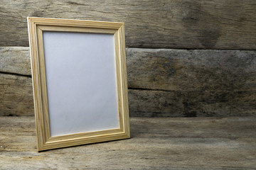 Wood photo frame on wooden table