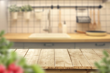 wooden table and kitchen space