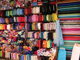 A Variety of Materials for Sale at a Haberdashery Store.