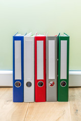 Folders in a row on table