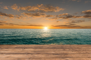 Empty top of wooden floor and view of tropical beach. For product display