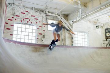 Young woman skateboarding.