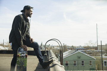 A young man on a roof.