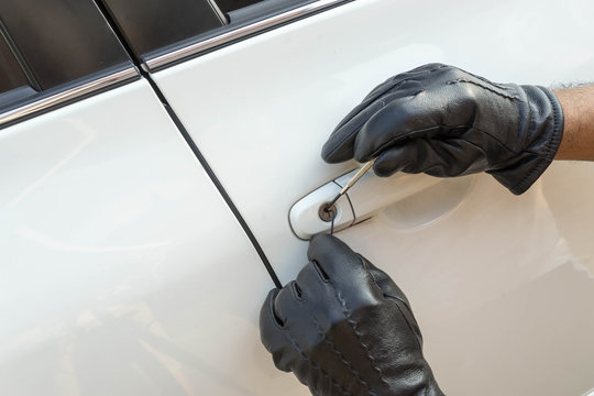 locksmith car on black grove and white door