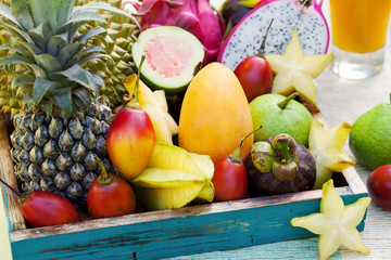 Assortment of tropical exotic fruits with smoothie and fresh juice
