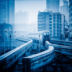 moving metro monorail in chongqing,china,blue toned image.