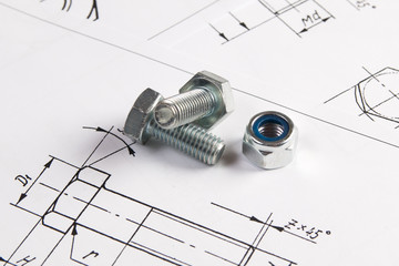 Engineering drawings and metal bolt. Science, mechanics and mechanical engineering.