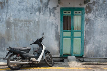 Old door and bike in Georgetown, Penang, Malaysia