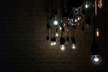 Incandescent lamps on a brick wall background.