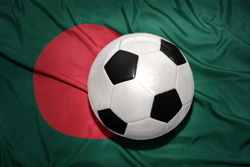 black and white football ball on the national flag of bangladesh